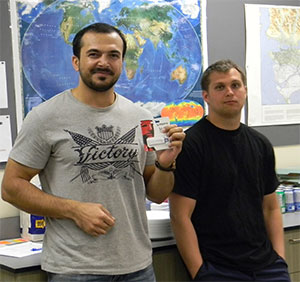 Door prize winner Mirwais Khan, celebrates with fellow Geography student Karel van Renesse