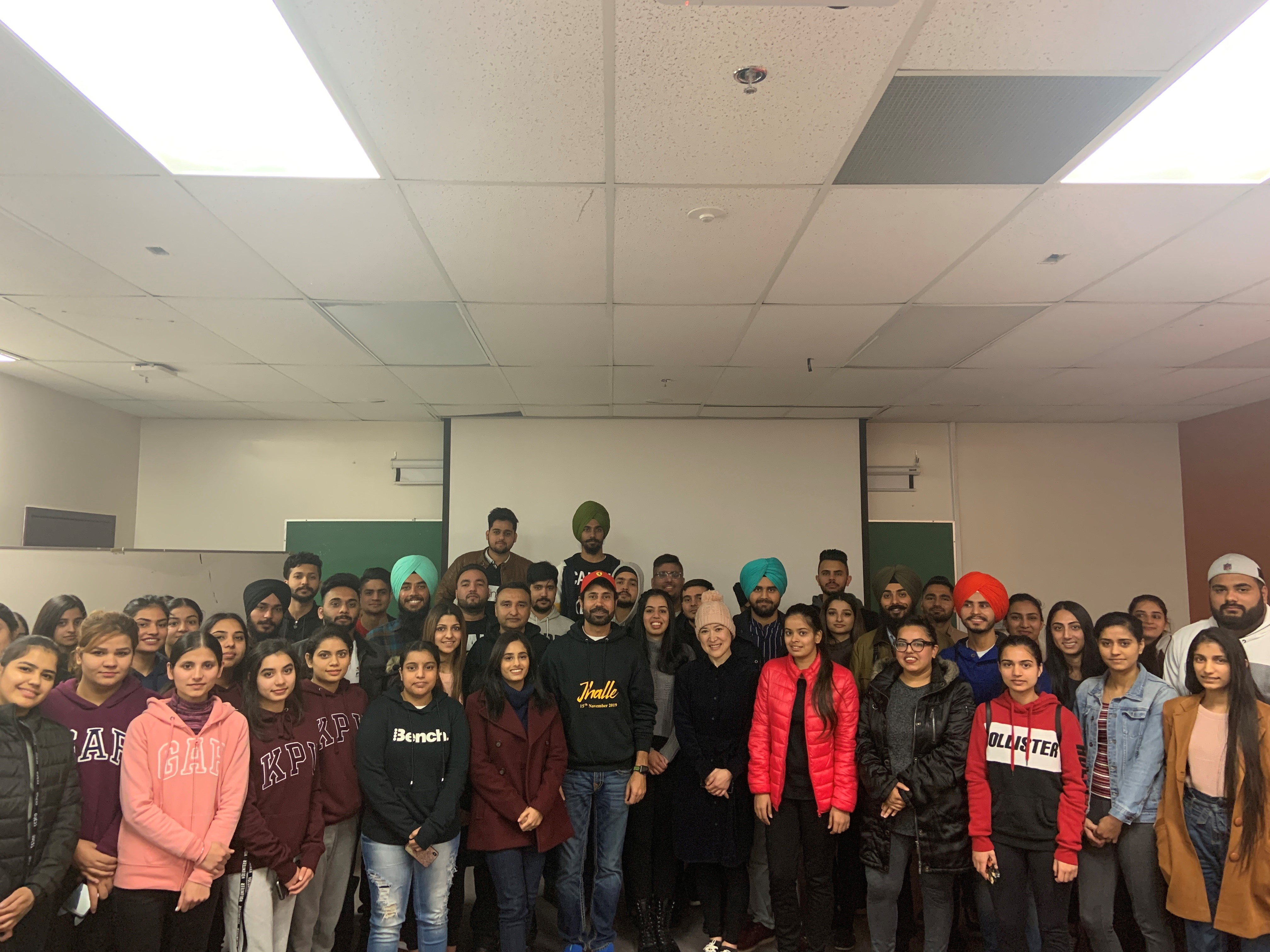 Binnu Dhillon with students
