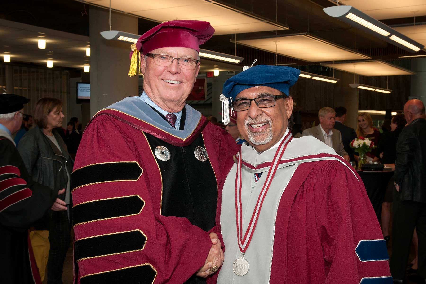Dr. Arvinder Bubber (right) was awarded an honorary degree by his successor, Dr. George Melville.