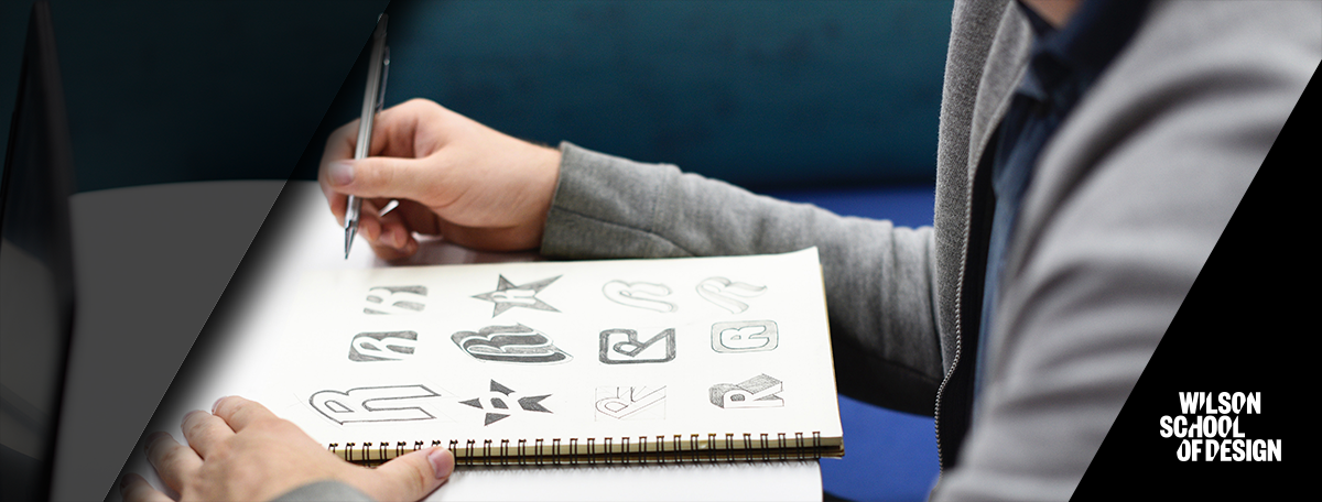 Student sketching in notebook.