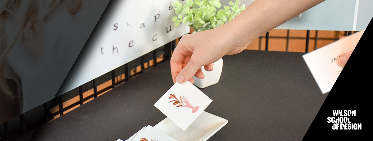 Business cards being laid out on a table.
