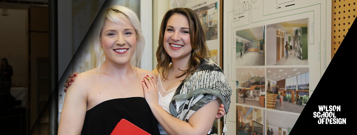 Two alumni interior design students.