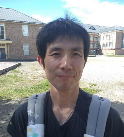 A photograph of Dr Eiji Okawa