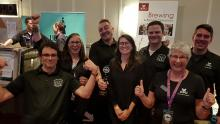 Students and instructors of KPU's Brewing program pose with their trophy.