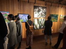 Attendees inspect art work done by Fine Arts students at the Fort Langley Historic Site.