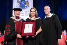 Kristan Ash receives award at convocation